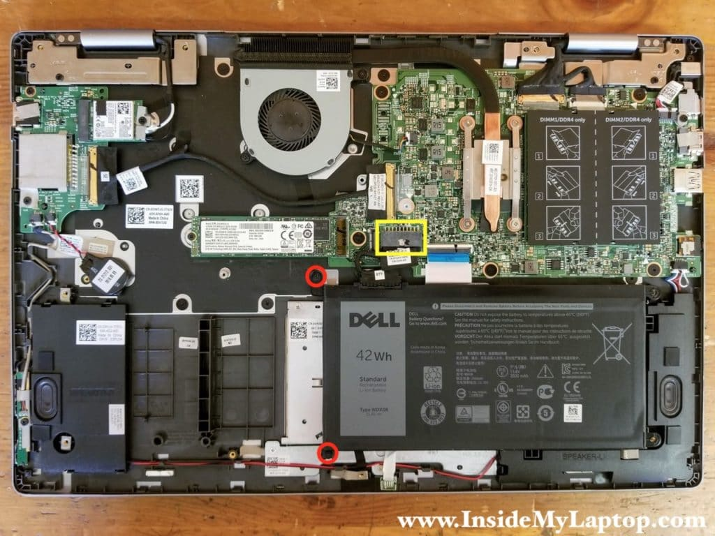 Remove two screw securing the battery on the left side. Disconnect the battery cable from the motherboard.