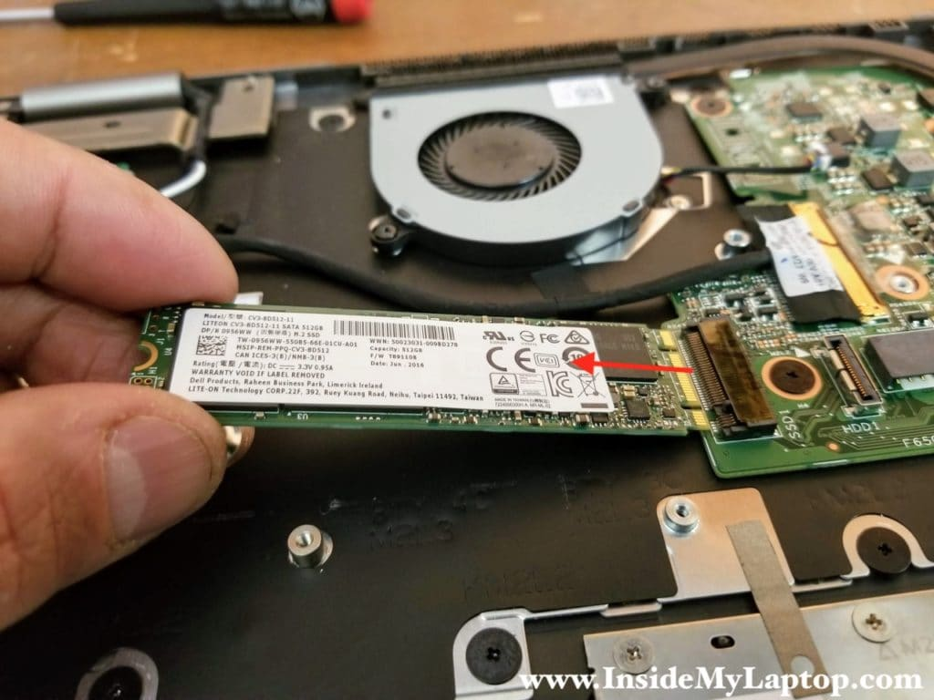 Remove one screw securing the solid state drive. Pull the SSD out.