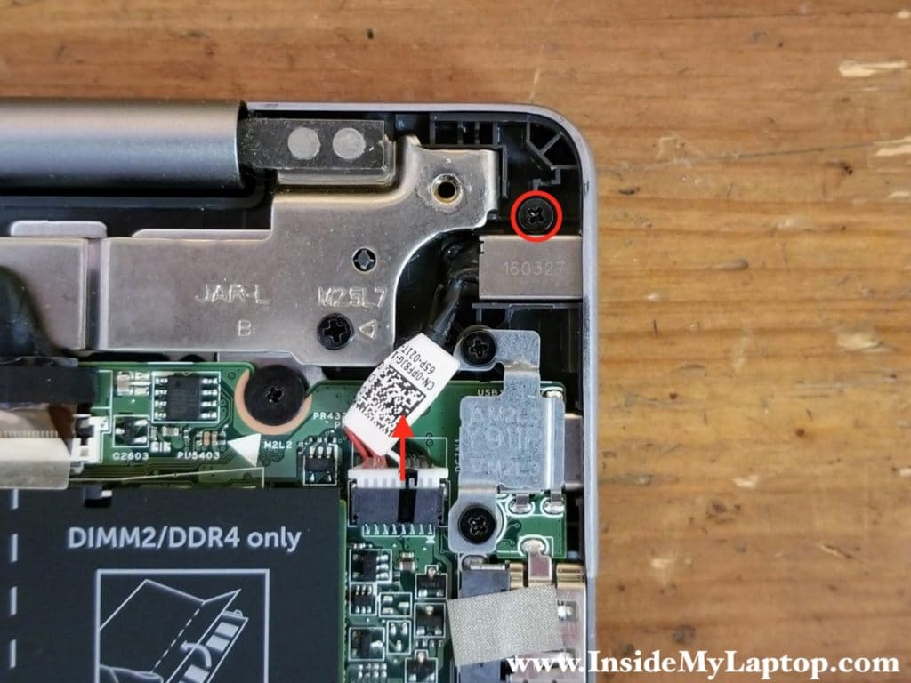Remove one screw securing the DC power jack. Disconnect the DC jack cable from the motherboard.