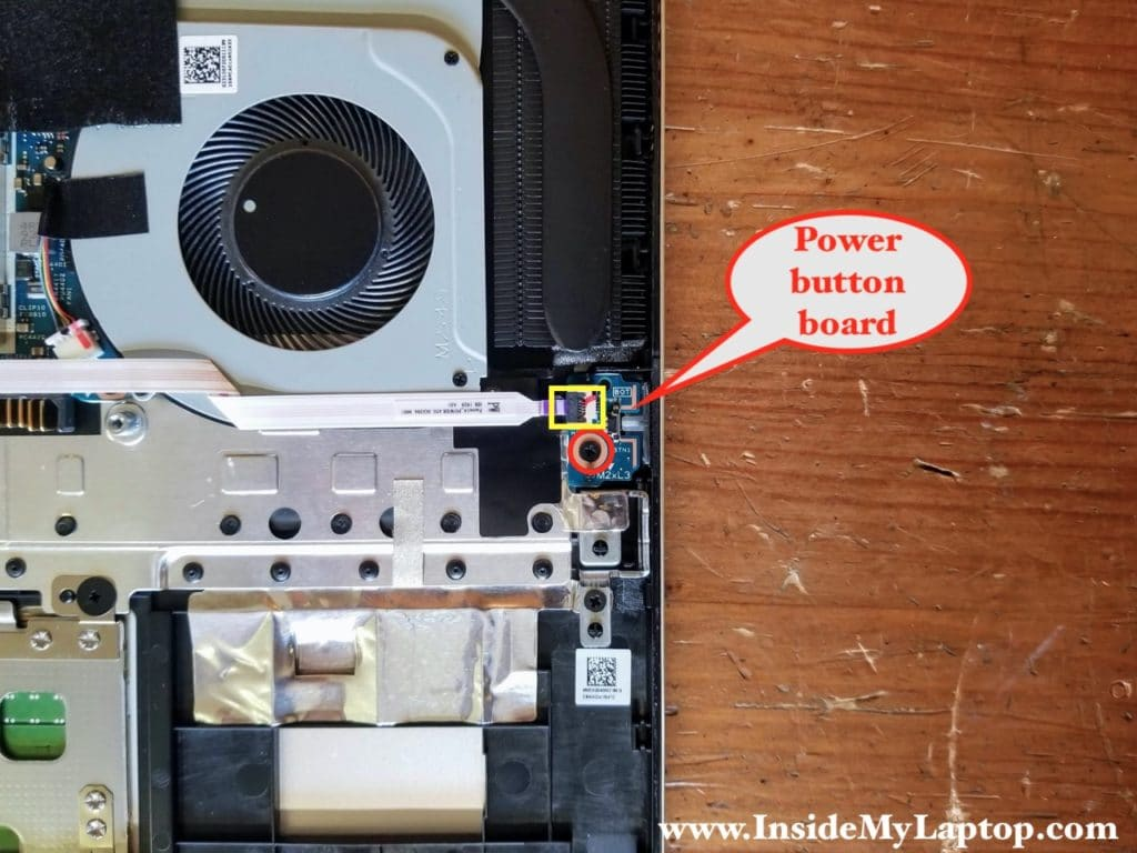 Remove one screw securing the power button board and disconnect the cable.