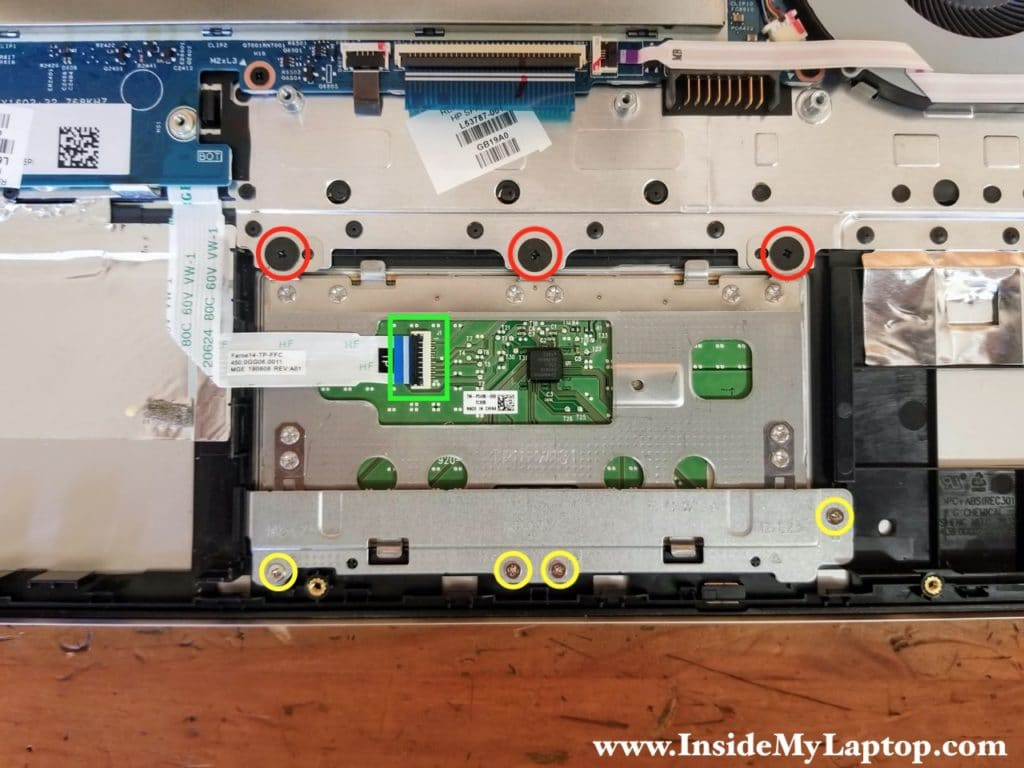 There are seven screws securing the touchpad to the top case assembly.