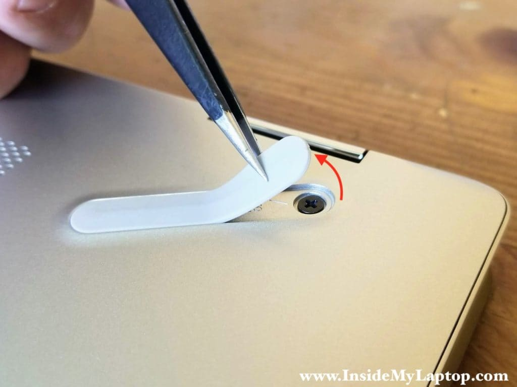 In order to access the hidden screw you'll have to peel off one side of the foot.