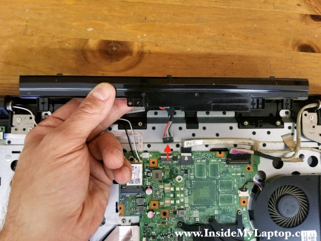 Lift up the battery and disconnect the battery cable from the motherboard.