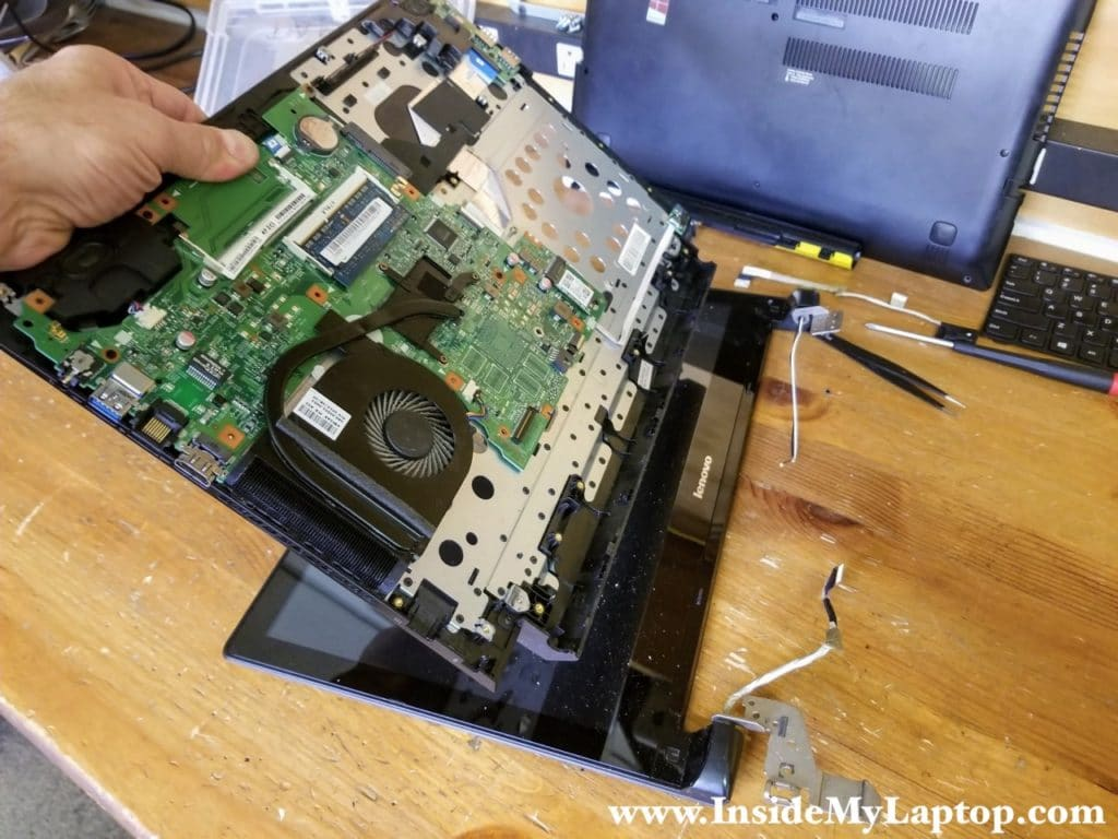 Remove the top case assembly.