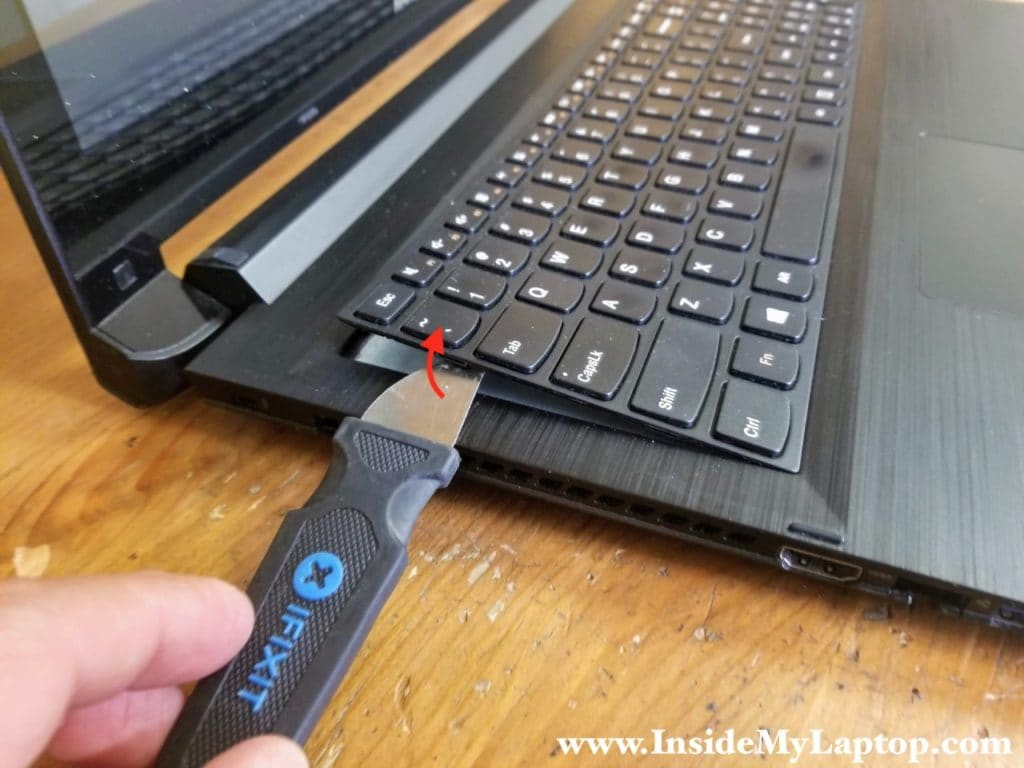 Pry up the keyboard using thin metal case opener tool or other similar tool.