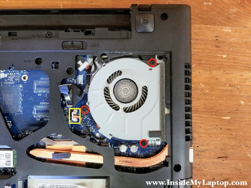 Remove three screws securing the cooling fan and disconnect fan cable from the motherboard.