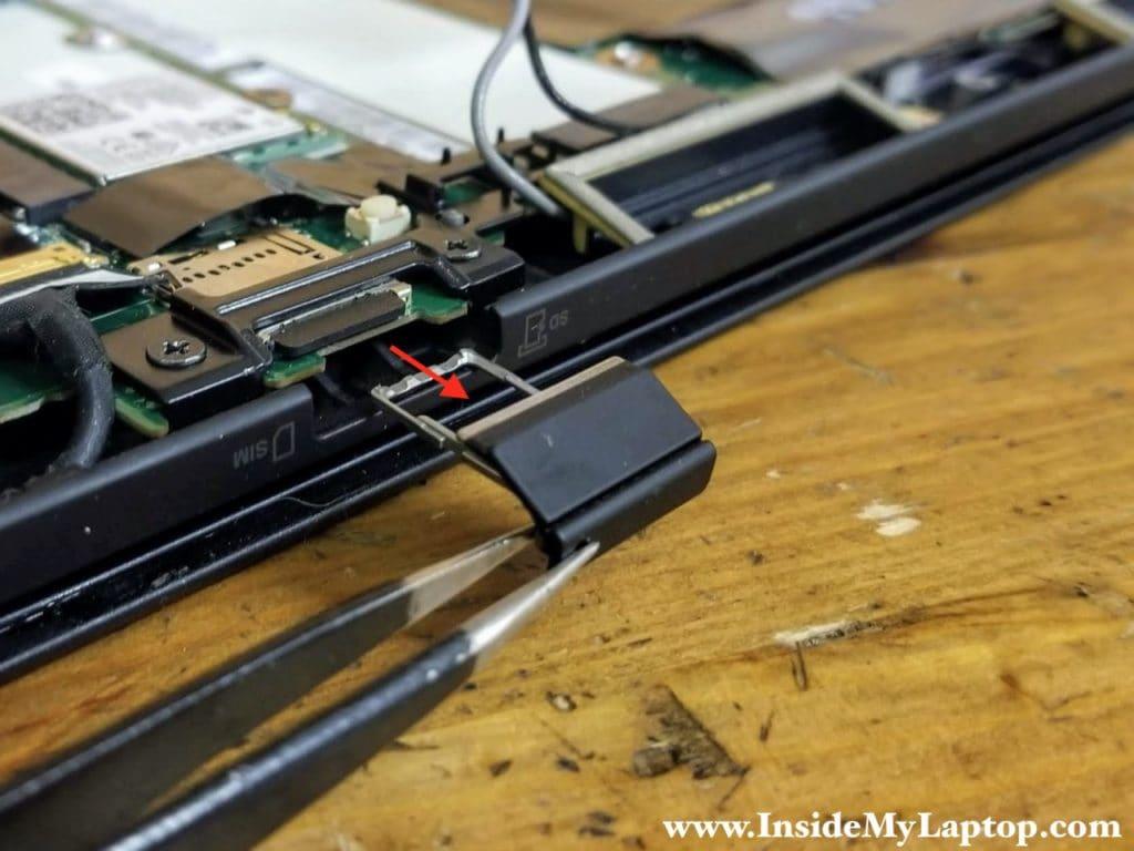 Remove the SIM/MicroSD card tray.