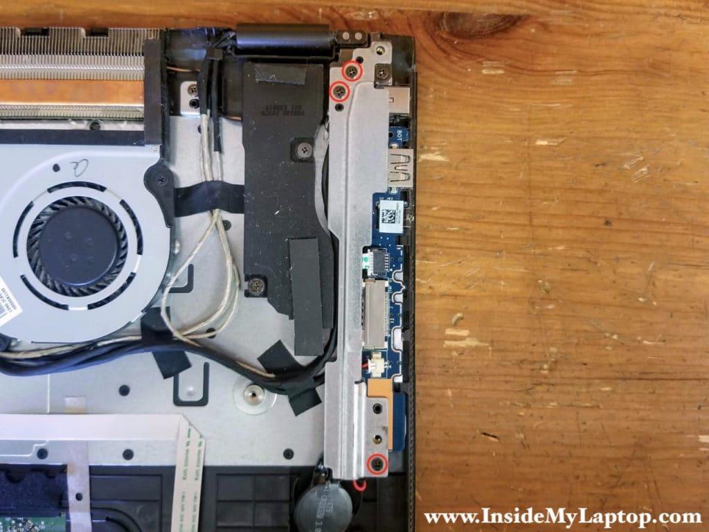 Remove three screws securing the left display hinge bracket.