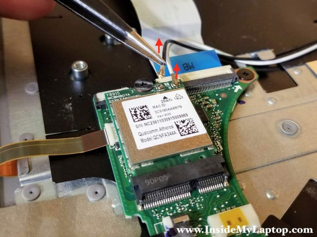 Using tweezers carefully disconnect both antenna cables from the wireless card.