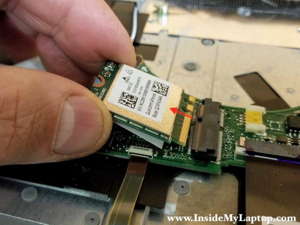 Remove one screw securing the wireless card. Pull the wireless card out of the slot.