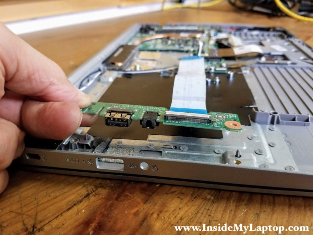 Lift up and remove the USB audio jack board.