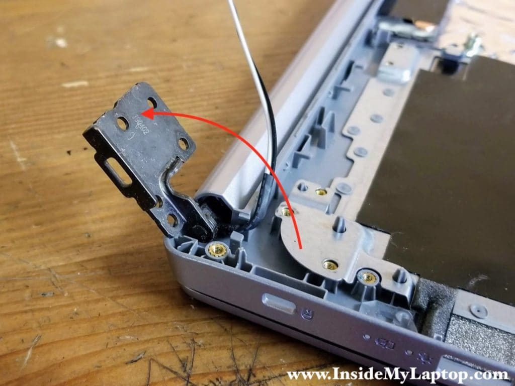 Open up the right display hinge.