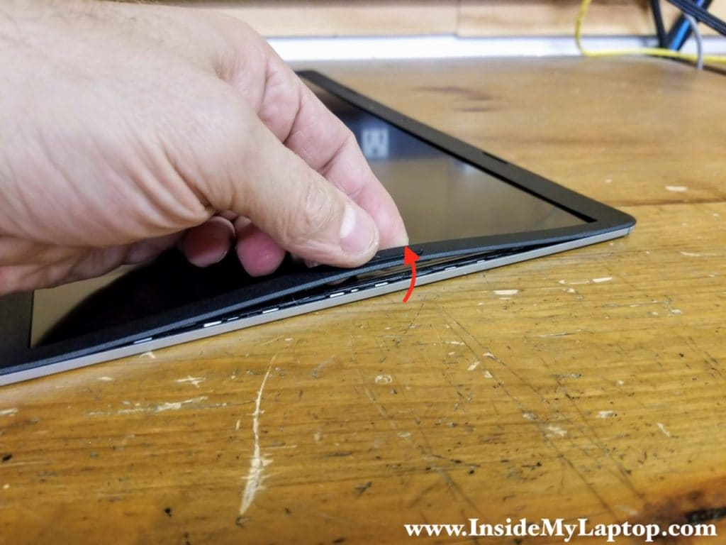 Separate the screen bezel from the display cover.