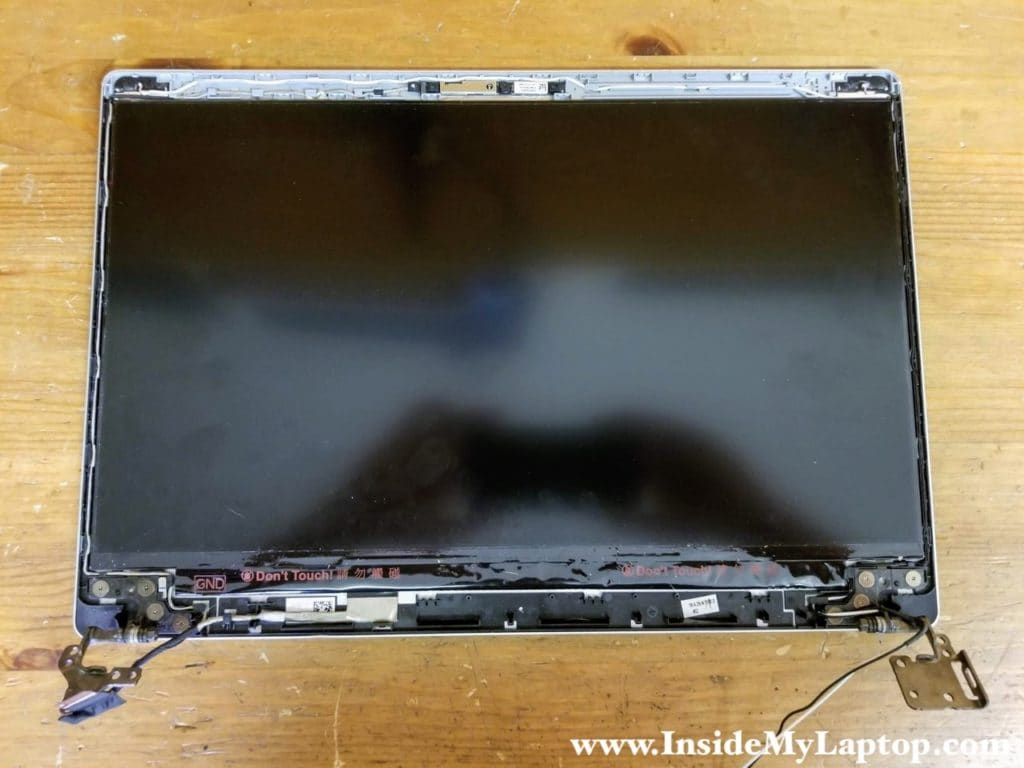 When the bezel was removed, I found that the LCD screen is glued to the display cover.