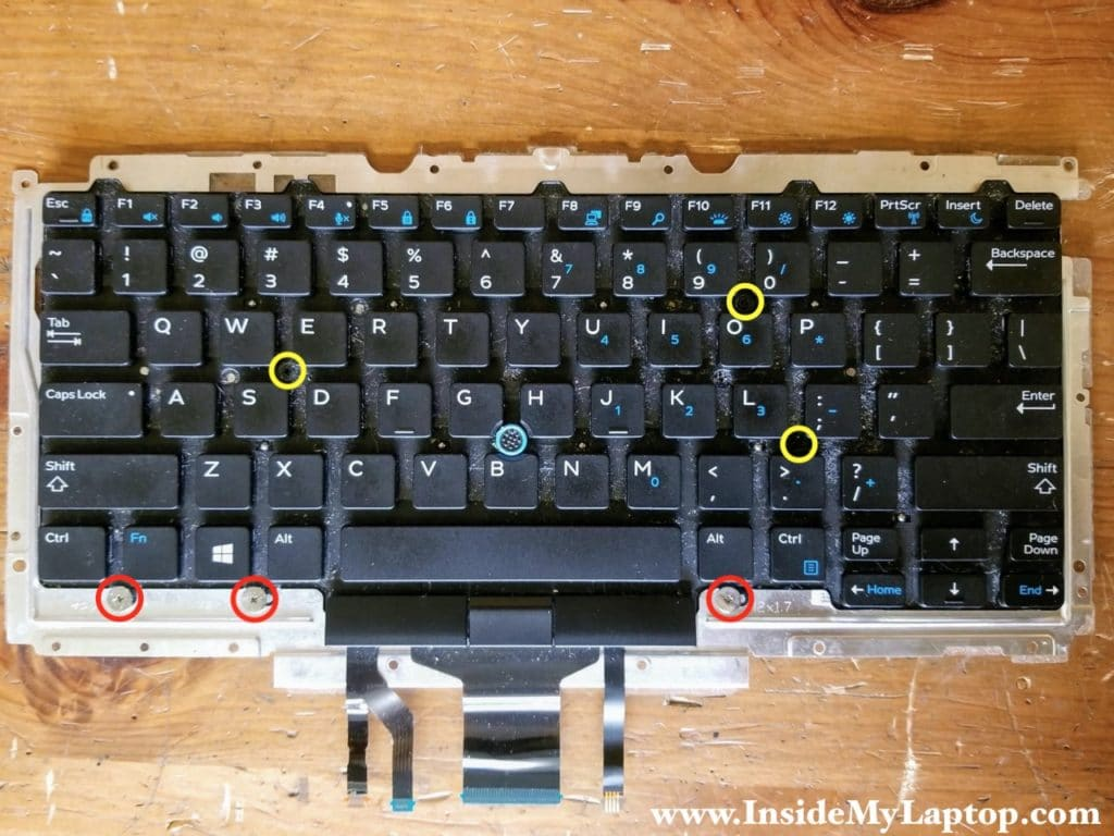Remove six more screws on the front side of the keyboard.