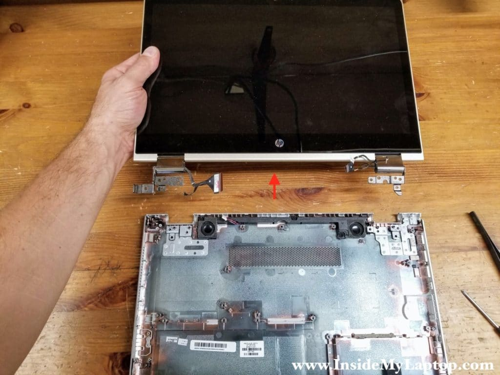 Lift up the display panel and remove it from the base assembly.