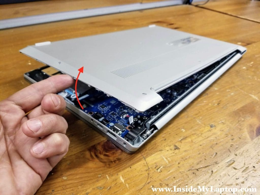 Continue removing the base cover with your hands.