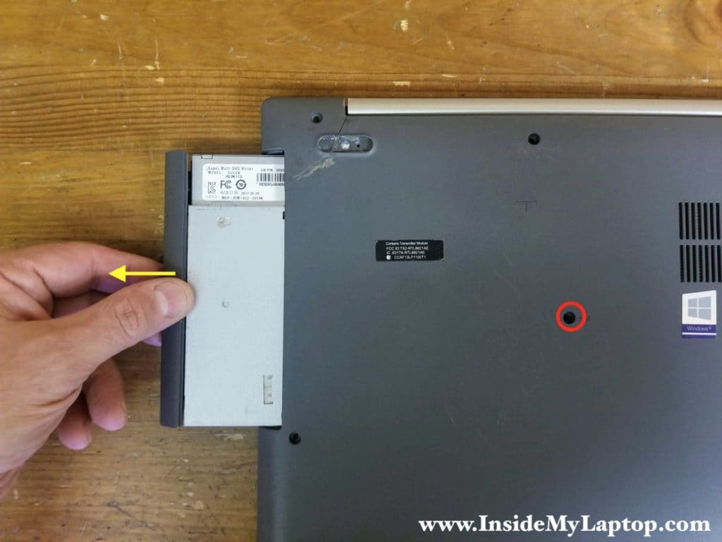 Remove one screw securing the optical drive and pull the drive out.