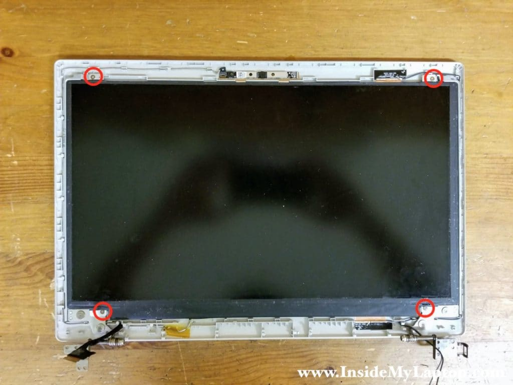 Remove four Phillips screws securing the LCD screen to the display back cover.