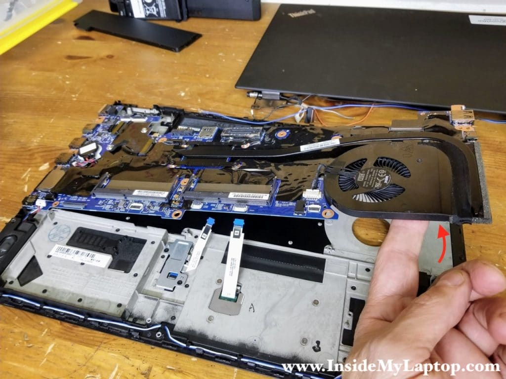 Carefully separate the motherboard from the top case and remove it.