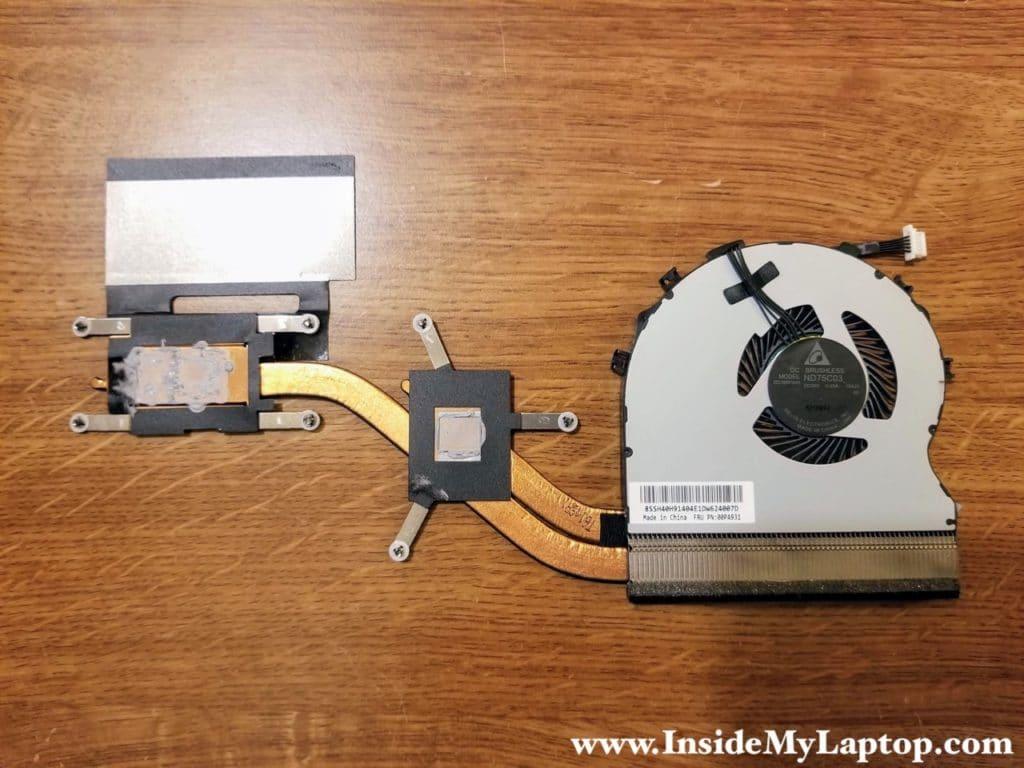 Heatsink/fan assembly removed. FRU part number is 00PA931.