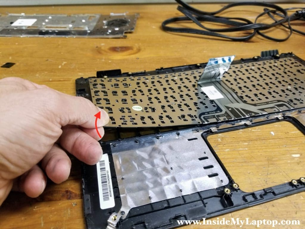 Separate the keyboard from the top case.