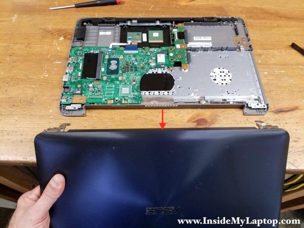 Separate the display panel from the top case assembly.