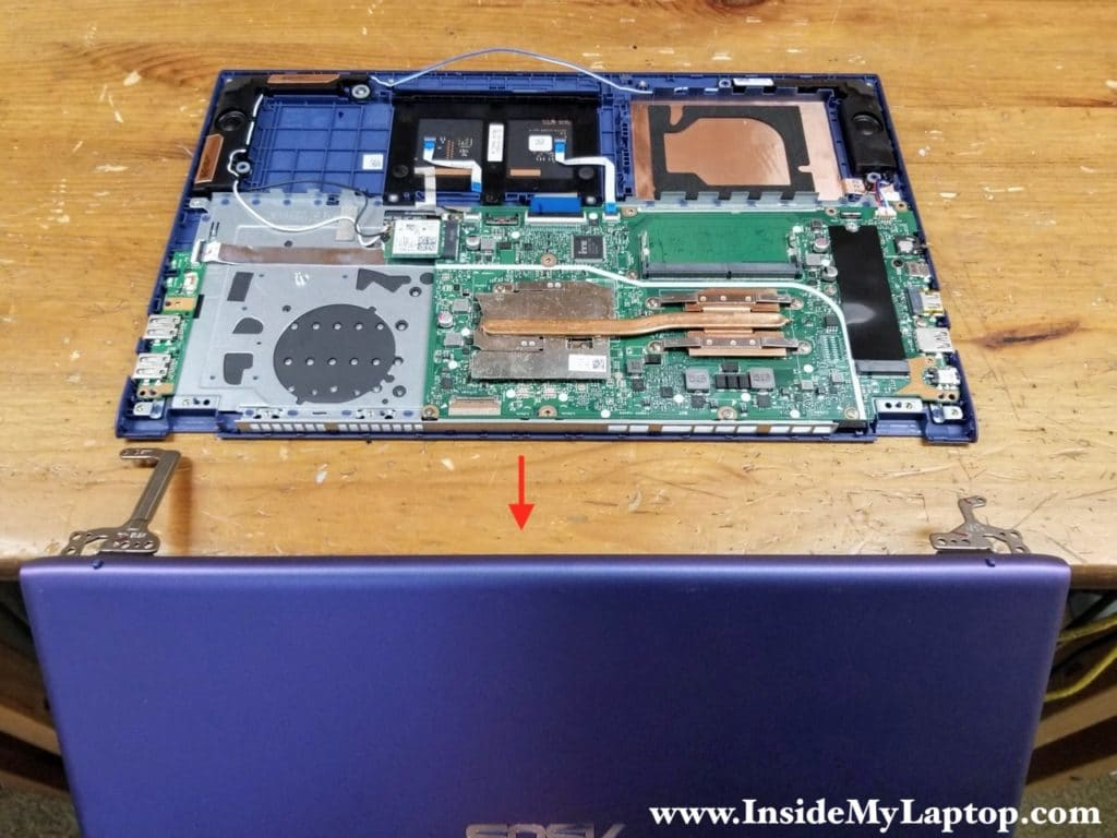 Now you can separate the display panel from the top case assembly and remove it.
