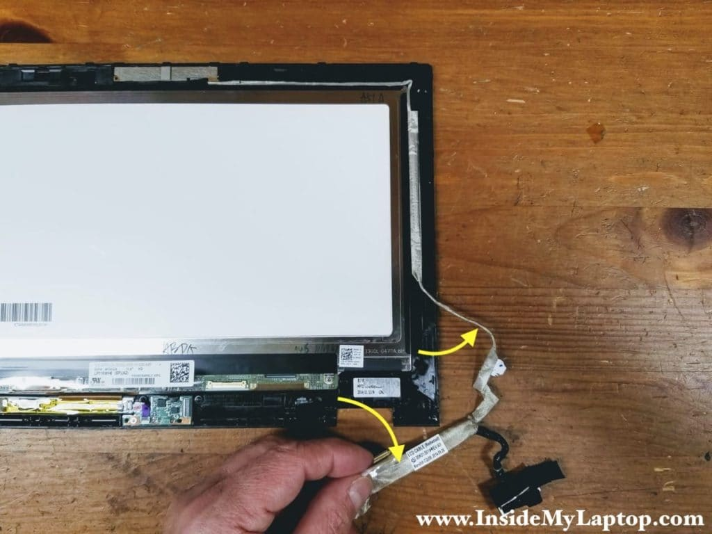 Start separating the display harness from the right side of the bezel.