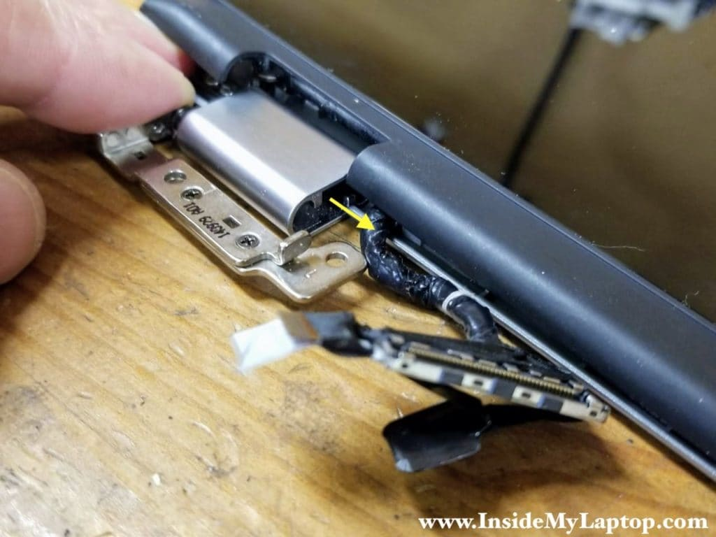 Carefully pull the display cable out of the left hinge cover.