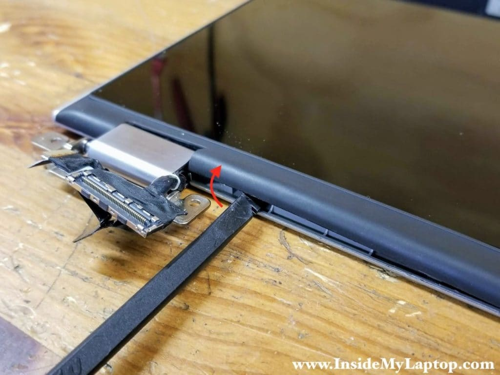 Start separating the touchscreen assembly from the display back cover on the bottom part of the display panel.