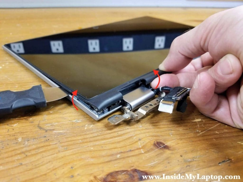 Continue removing the touchscreen assembly around the hinge area.