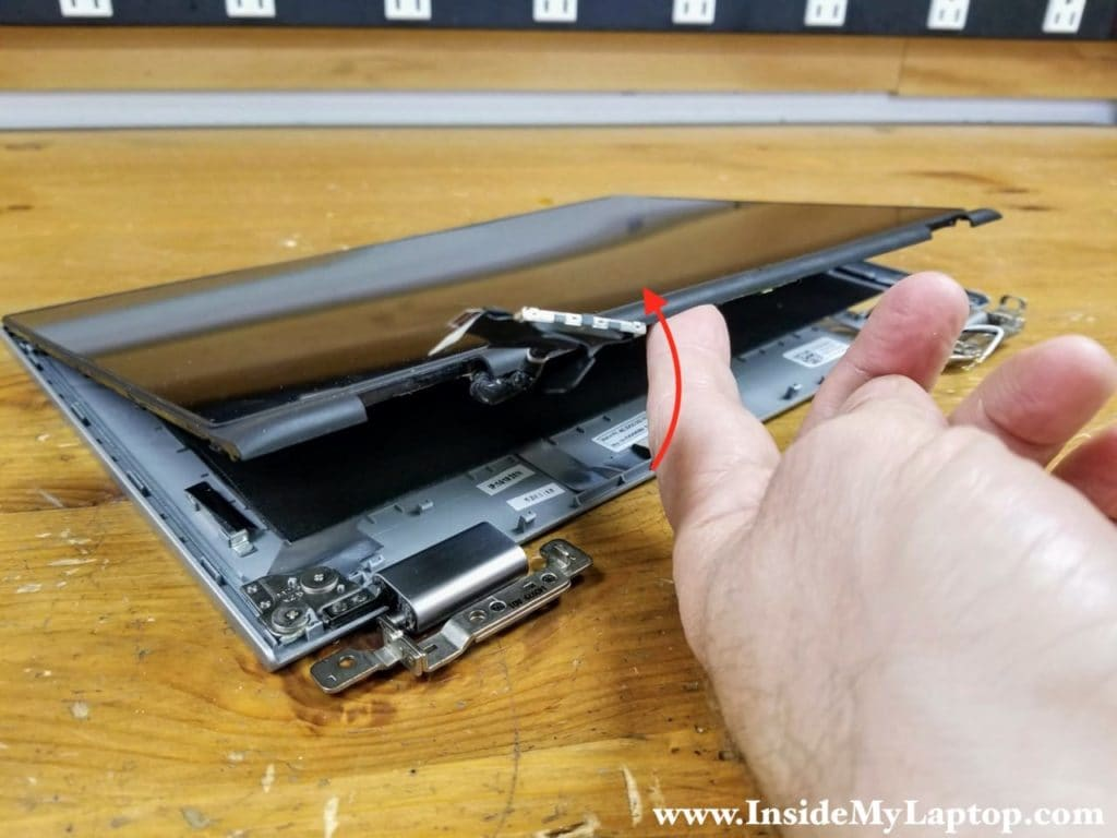 Separate the bottom side of the touchscreen assembly from the display back cover.