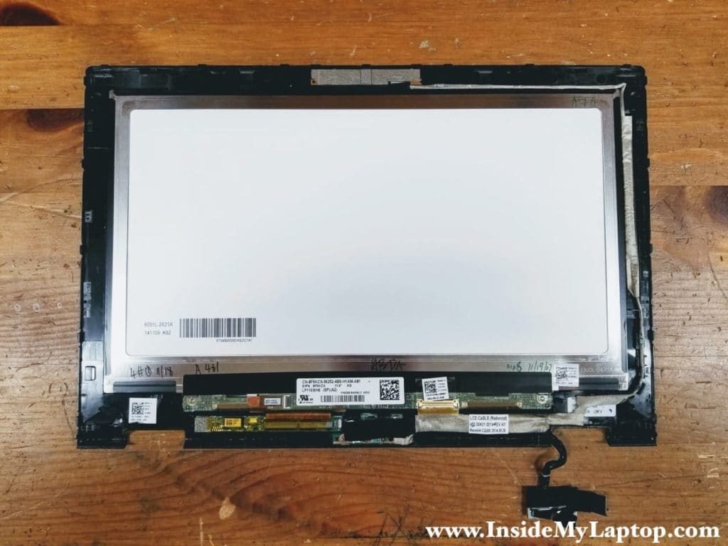 The webcam and display cable harness is routed on the right side of the display panel.
