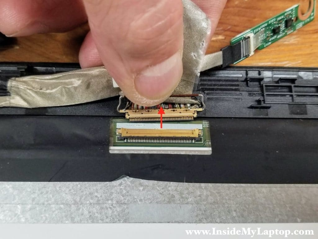 Disconnect the display cable from the LCD screen.