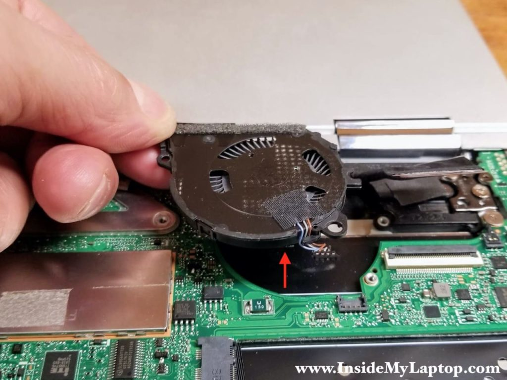 Lift up and remove the left cooling fan.