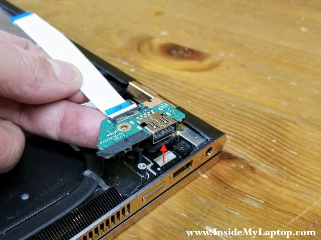 Lift up and remove the USB power button board with the I/O cable attached.